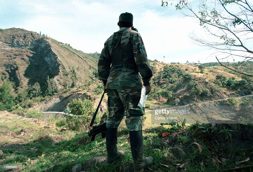 Guerrilla commander Oscar Rondon of the Revolutionary Armed Forces of Colombia (FARC) stands March 7, 2002 in the mountains near Bogota, Sumapaz, Colombia. The group has 'invited peacefully' the Colombian people to boycott Senatorial elections on March 10, as the FARC has branded them antidemocratic.