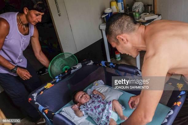 FARC guerrilla Esperanza takes care of her baby Desire at their camp in the Transitional Standardization Zone in Pondores La Guajira department...