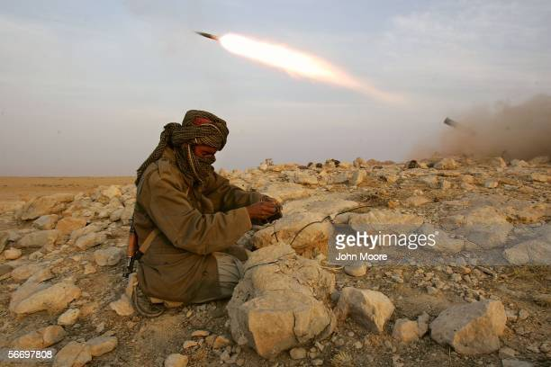 A guerrilla from the Marri tribe fires a rockets at a Pakistani military position January 29 2006 near Kahan in the Pakistani province of...