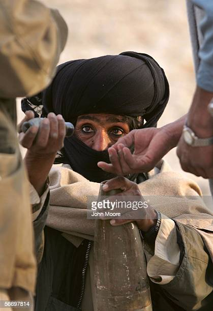 A guerrilla from the Marri tribe prepares BM12 rockets for firing on a Pakistani troop outpost January 29 2006 near Kahan in the Pakistani province...