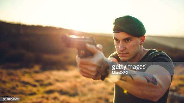 Guerrilla soldier with handgun