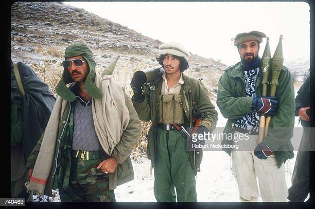 Guerrilla soldiers carry artillery to the front from a remote base in the Safed Koh Mountains February 10, 1988 in Afghanistan. A Soviet-supported...