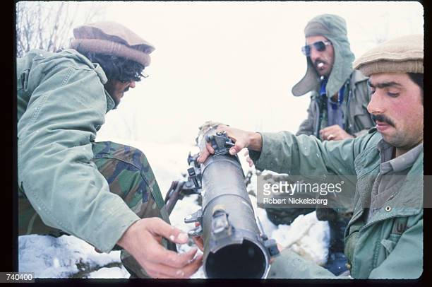 Guerrilla soldiers load a BM12 launcher at the front near a remote base in the Safed Koh mountains February 10 1988 in Afghanistan A Sovietsupported...