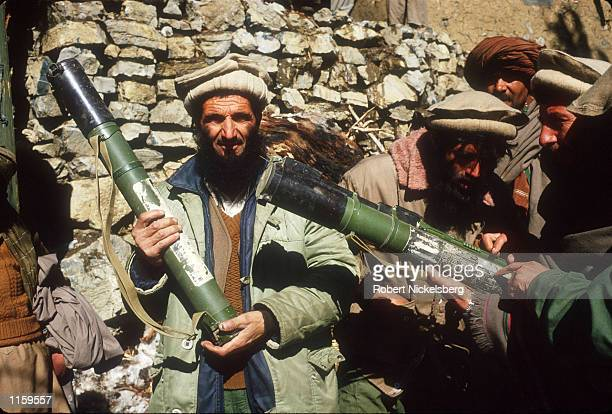 Guerrilla soldiers or mujahadeen stand with artillery at a remote base in the Safed Koh Mountains February 10, 1988 in Afghanistan. The end of Soviet...