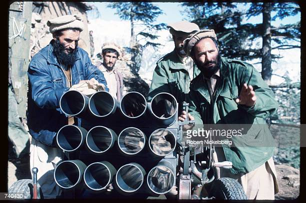 Guerrilla soldiers stand with a piece of artillery at a remote base in the Safed Koh Mountains February 10 1988 in Afghanistan A Sovietsupported...