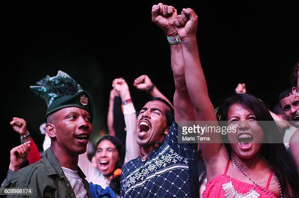 FARC guerrillas and supporters celebrate at a concert at the 10th Guerrilla Conference in the remote Yari plains where the peace accord was in the...