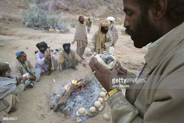 Guerrillas from the Bugti tribe make a traditional Baloch bread called cock while at a remote camp outside of Dera Bugti in the province of...