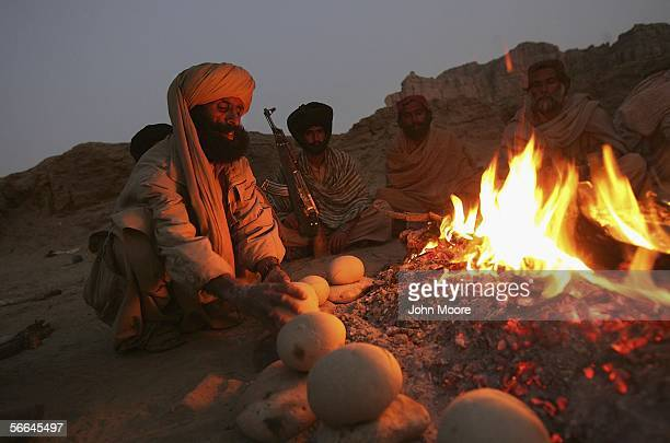 Guerrillas from the Bugti tribe make traditional Baloch bread called cock while at a remote camp outside of Dera Bugti in the province of Balochistan...