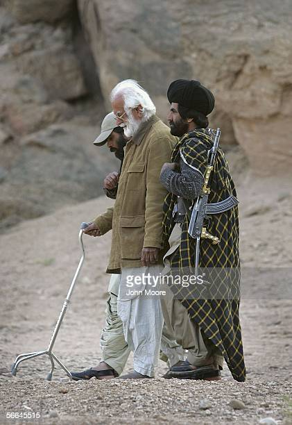 Guerrillas help Nawab Muhammad Akbar Bugti legendary chief of the Bugti tribe during his daily excercise at a remote camp outside of Dera Bugti in...
