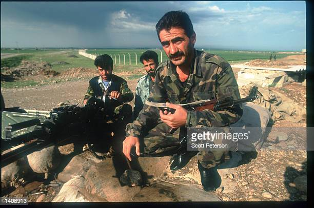 PUK guerrillas hold weapons April 16 1996 near the Iraq/Turkey in northern Iraq Efforts by the Kurds to achieve autonomy or independence for the...