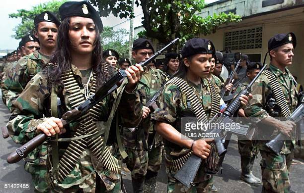 Guerrillas of the Marxist Revolutionary Armed Forces of Colombia march in a military parade 07 February 2001 in San Vicente. Amid rising tension and...