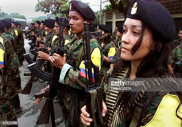 Guerrillas of the Marxist Revolutionary Armed Forces of Colombia participate in a military parade 07 February 2001 in San Vicente Amid rising tension...