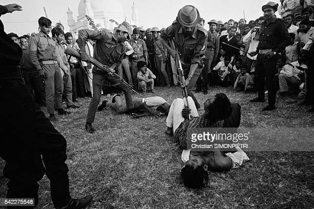 Execution in a stadium in Dhaka of five 'Razakars' members of a proPakistani militia regarded as collaborators by the Bengalis General Abdul Khader...
