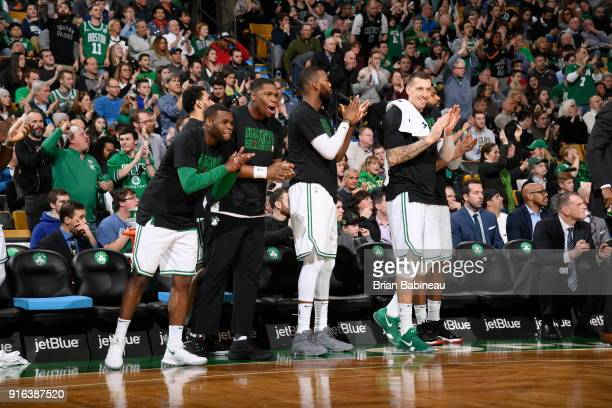 Guerschon Yabusele and Daniel Theis of the Boston Celtics react to a play against the Indiana Pacers February 9 2018 at the TD Garden in Boston...