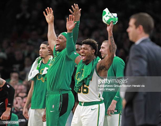 Guerschon Yabusele and Marcus Smart of the Boston Celtics scream out in celebration during the second half of the NBA game against the Toronto...