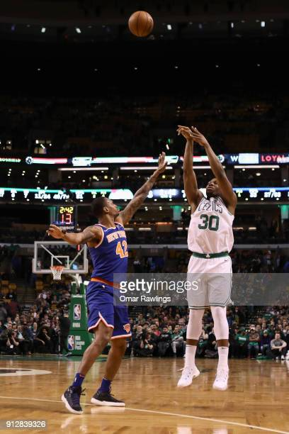Guerschon Yabusele of the Boston Celtics shoots the ball over Lance Thomas of the New York Knicks during the fourth quarter of the game against the...