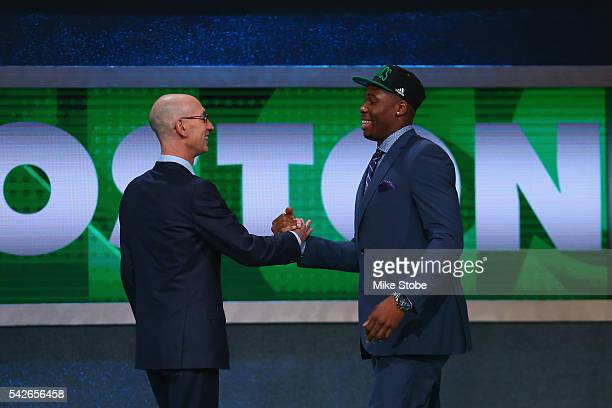 Guerschon Yabusele shakes hands with Commissioner Adam Silver after being drafted 16th overall by the Boston Celtics in the first round of the 2016...