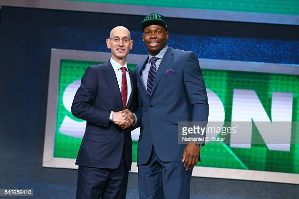 Guerschon Yabusele shakes hands with NBA Commissioner Adam Silver after being selected number sixteen overall by the Boston Celtics during the 2016...