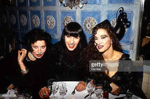 Guesh Patti Chantal Thomass and a singer attend a fashion week Party at Les Bains Douches in the 1990s in Paris France