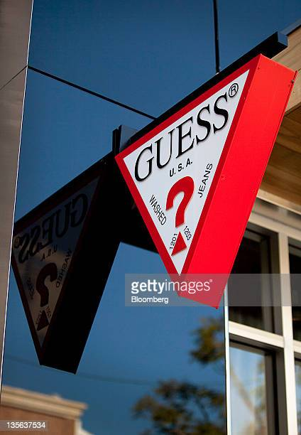 Guess Inc signage is displayed outside of a Guess store at the Third Street Promenade outdoor mall in Santa Monica California US on Monday Dec 5 2011...