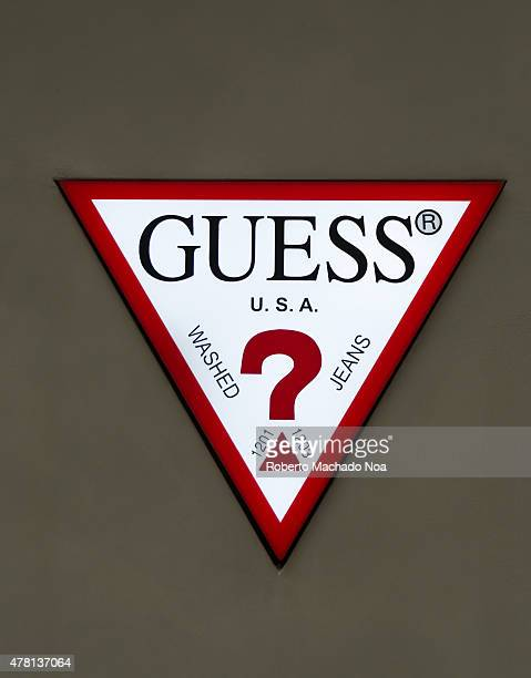 CENTRE TORONTO ONTARIO CANADA Guess Logo on wall White triangle with red border and black letters forming the logo for Guess