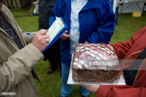 A guess the weight of the cake contest at the Ashdon Village Summer Fete The event helped raise funds for a local charity | Location Saffrom Walden...