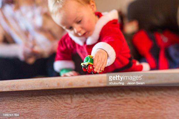 guess who got a toy train for christmas? - totland bay stock pictures, royalty-free photos & images