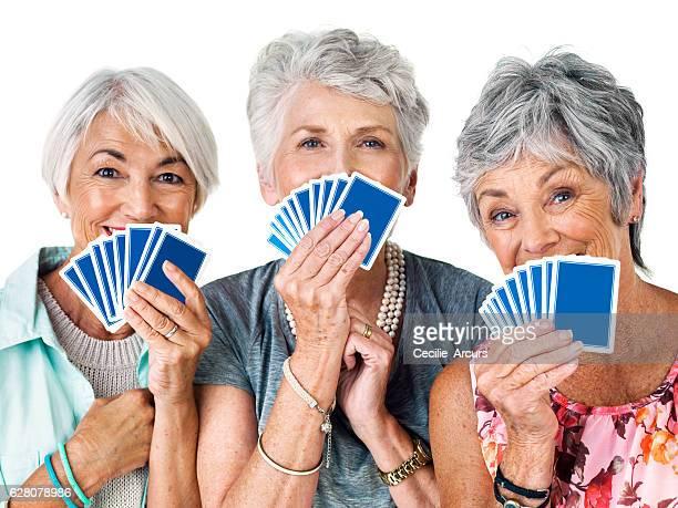 guess who has the winning hand - bridge card game stock-fotos und bilder