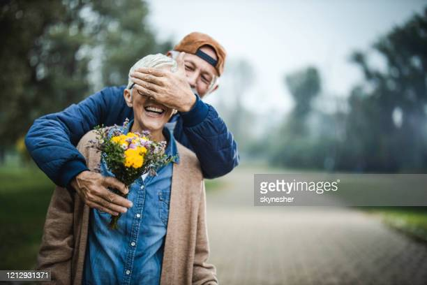 guess who? - hands covering eyes stock pictures, royalty-free photos & images
