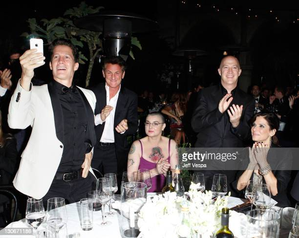 Guest actor Sean Penn singer Sinead O'Connoe CAA Managing Director Bryan Lourd and actress Sandra Bullock attend The 2011 amfAR Inspiration Gala Los...
