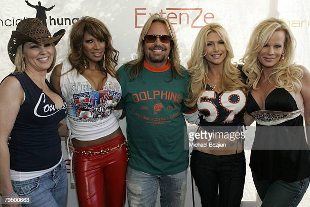 Guest actress Traci Bingham recording artist Vince Neil playmate Brande Roderick and Lia Gerardini arrive at the Playboy Mansion Super Bowl Party on...