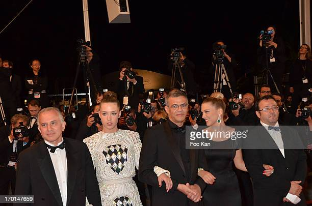 A guest Adele Exarchopoulos director Abdellatif Kechiche Lea Seydoux and a guest attend 'La Vie D'Adele Chapitre 1 2 Blue Is The Warmest Color'...