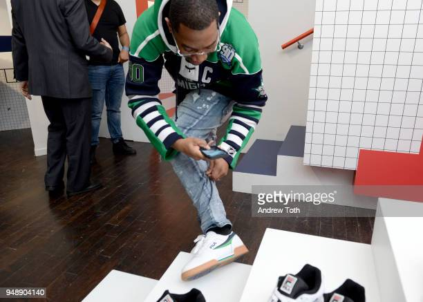 A guest admires sneakers on display at the Launch of the FILA Mindblower PopUp Powered by Ciroc on April 19 2018 in New York City