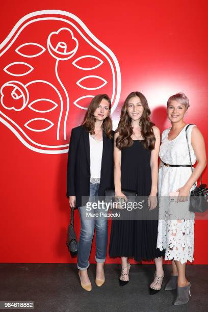 A guest Aleksandra Zharkova and Nastasia Nikonova attends the #Ultimune Launch Event on May 31 2018 in Paris France