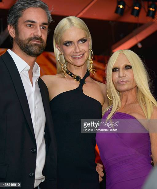 Guest Ana Claudia Michels and Donatella Versace attend the Versace for Riachuelo fashion show during Sao Paulo Fashion Week Winter 2015 at Pavilhao...