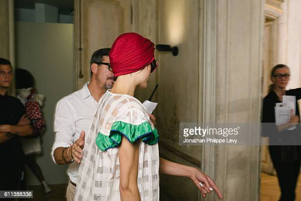 Guest and a Model poses prior the Tsumori Chisato Presentation as part of the Paris Fashion Week Womenswear Spring/Summer 2017 on September 29 2016...