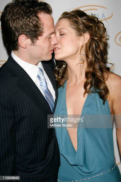 A guest and actress Ali Hillis arrives at the Lupus LA's 2008 Orange Ball on May 1 2008 at The Beverly Wilshire in Beverly Hills California