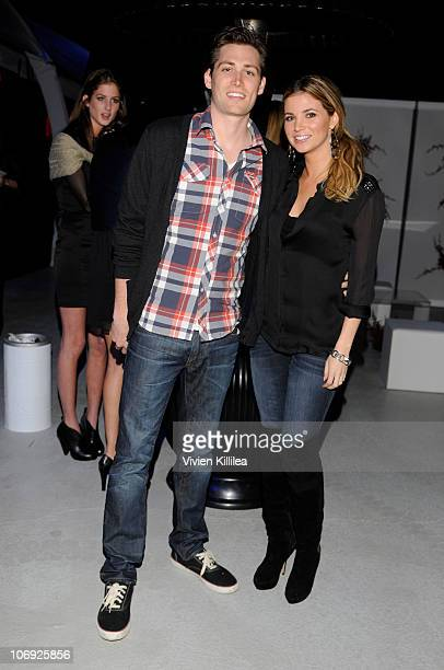 A guest and actress Amber Lancaster attend An Evening With Chrysler on November 16 2010 in Los Angeles California