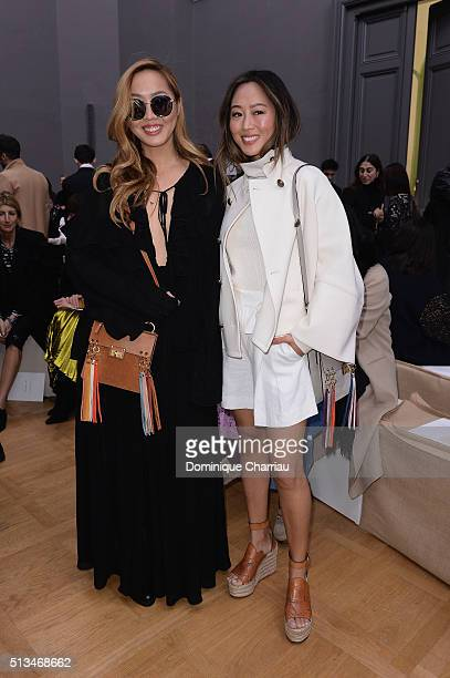 A guest and Aimee Song attend the Chloe show as part of the Paris Fashion Week Womenswear Fall/Winter 2016/2017 on March 3 2016 in Paris France