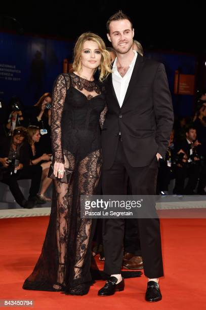 Guest and Alexandra Dinu walk the red carpet ahead of the 'Loving Pablo' screening during the 74th Venice Film Festival at Sala Grande on September 6...
