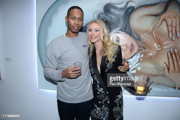 Guest and Alexandra Houx Grounds attend Delusions of the Wild Solo Exhibition By Alexandra Houx Grounds at 213 Bowery on October 17 2019 in New York...