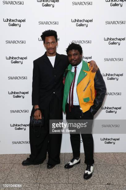 Guest and Alvaro Barrington attend a glamorous gala dinner as Francis Alys is celebrated as Whitechapel Gallery Art Icon with Swarovski on January 21...
