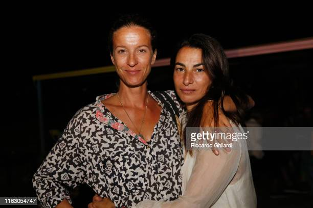 Guest and Annalisa Bugliani attend the welcome dinner celebrating the opening of Rachel Lee Hovnanian's museum show Open Secrets at Alle Boe Beach...