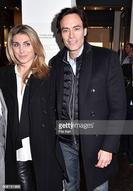 A guest and Anthony Delon attend the Mireille Darc Photo Exhibition Preview at Artcurial on January 21 2016 in Paris France