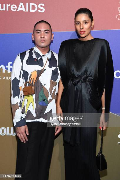 Guest and Babba RIvera attend the amfAR Gala Milano 2019 at Palazzo Mezzanotte on September 21, 2019 in Milan, Italy.