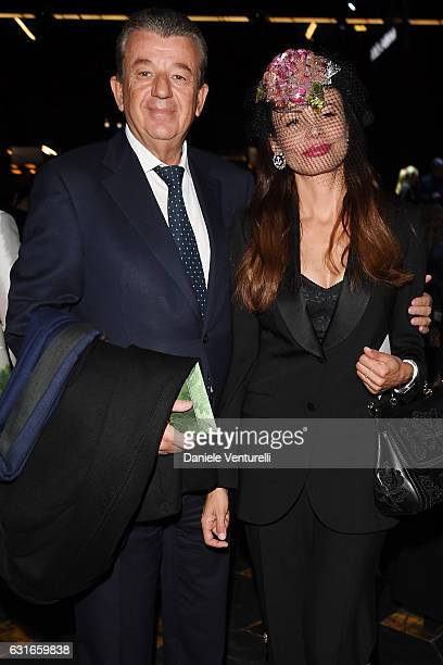 Guest and Beata Ben Ammar attends the Dolce Gabbana show during Milan Men's Fashion Week Fall/Winter 2017/18 on January 14 2017 in Milan Italy
