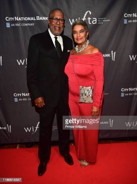 Guest and Camille Russell Love attend the 2019 WIFTA Gala at Four Seasons Hotel on November 9 2019 in Atlanta Georgia