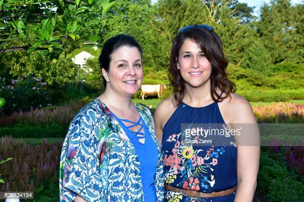 Guest and Catherine Philbin attend ARF in the Garden of Peter Marino at a Private Residence on July 15 2017 in Southampton NY