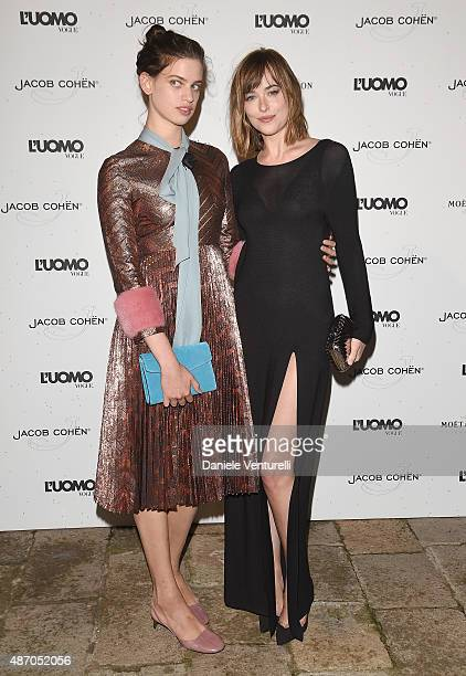 guest and Dakota Johnson attends the 'Being The Protagonist' Party hosted By L'Uomo Vogue during the 72nd Venice Film Festival at San Clemente Palace...
