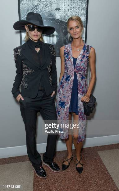 Guest and Elena Kurnosova attend after party for 30th anniversary fashion show during New York SS20 fashion week at 3 West Club